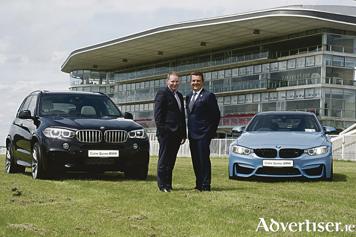 Michael Moloney, general manager of the Galway Racecourse, with Colm Quinn of Colm Quinn BMW, sponsors of Tuesday's meeting of the Galway Races.