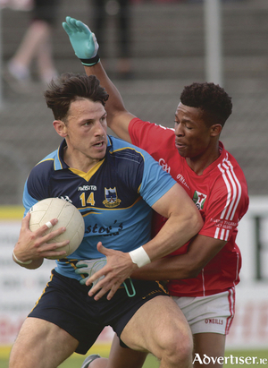 Salthill Knocknacarra's Sean Armstrong comes under pressure from Tuam Stars' corner back Brendan Mashengele in action from the Galway Senior Football Championship game at Kenny Park, Saturday. Photo:-Mike Shaughnessy