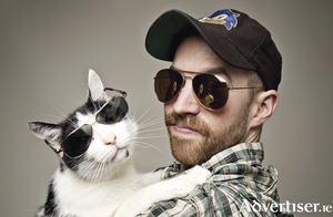 Damien Clark and feline friend.
