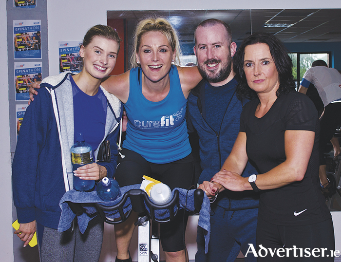 Exhausted but worth the effort - organiser Jocelyn Cunningham (on bike)  pictured with Catwalk model Katie Geoghegan, Kieran O'Malley aka The Galway Player and Purefit's Fiona Fleming.