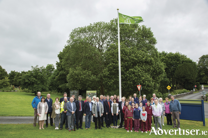 Cathaoirleach of Castlebar Municipal District, Cllr Michael Kilcoyne, Cathaoirleach of Mayo County Council Cllr Al Mc Donnell with other councillors, council staff, Turlough Park staff and village residents and pupils from Park National School at the raising of the Green Flag.