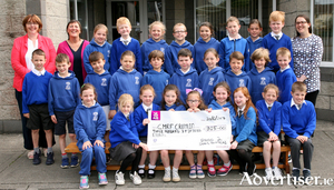The 2nd class pupils of Scoile Raifteiri, Castlebar who donated some of their First Holy Communion  money to Crumlin Hospitai with a cheque of €315euro and a cheque of €200 and a toy kitchen to the children's ward of Castlebar Hospital. Pictured are the pupils with their teachers. Photo: Heverin Print.