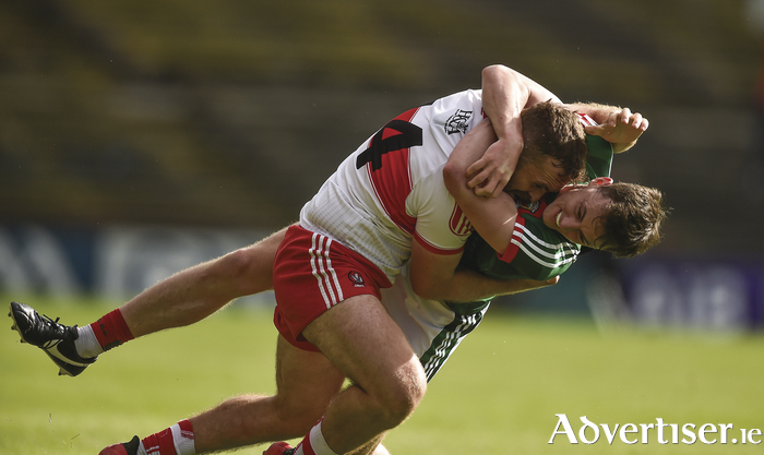 No holding back: Diarmuid O'Connor and Emmett McGuckin battle it out. Photo: Sportsfile