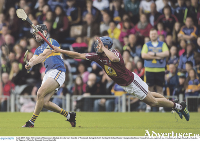 Aidan McCormack of Tipperary is blocked down by Gary Greville.  Photo: Diarmuid Greene/Sportsfil