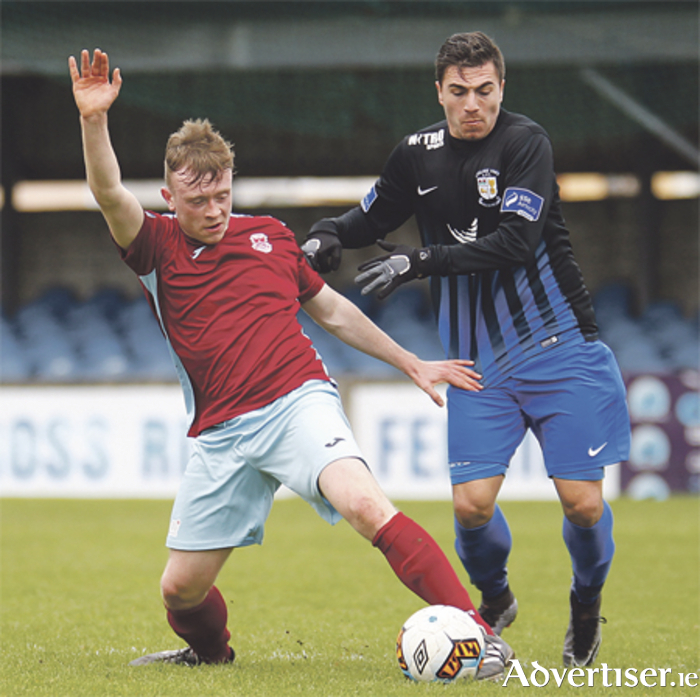 Athlone Town goalscoer, Dragos Sfrijan challenges Cobh  midfielder Scott McCarthy. Photo: Ashley Cahill/AC Sports Images