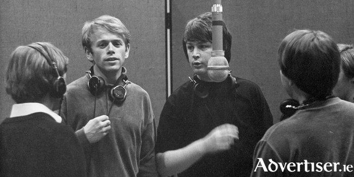 Al Jardine and Brian Wilson laying down vocals for Pet Sounds at Western Recorders studios in 1966.