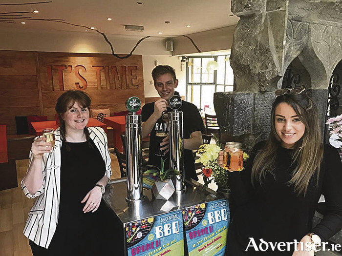 Áine Timlin enjoying the new Guinness taps being fitted in 56 Central with manager Rowena O'Brien and Hubert Dabrowski pulling the first pint of Guinness.
