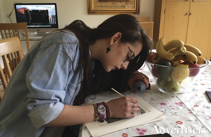 Artist Claire Talbot puts the  finishing touches to a print. Photo:- Grainne Galvin