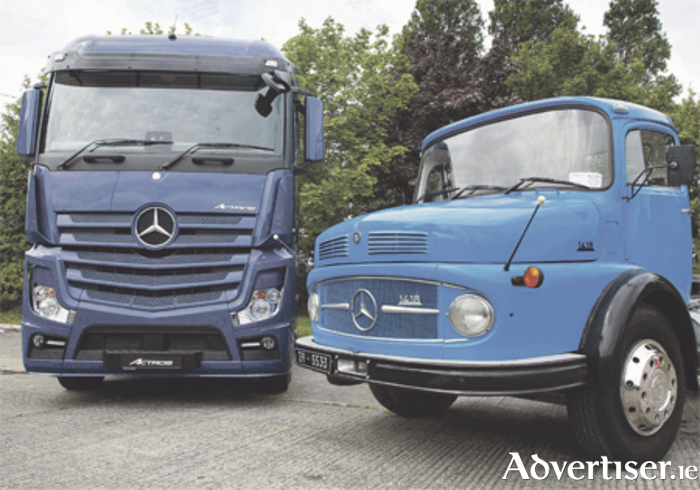 A fully restored Mercedes-Benz model 1418 'bull nose' - the first to be imported into Ireland in 1967 - pictured alongside a current model of the heavy-duty Actros, at an event to mark the 50th anniversary of Mercedes-Benz heavy commercial vehicles in Ireland