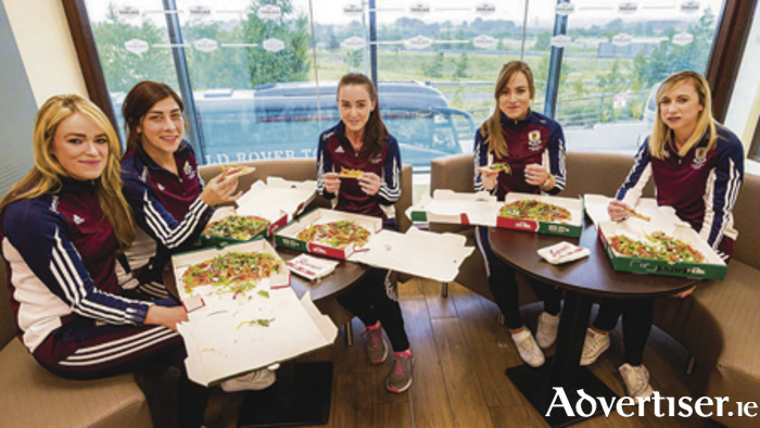 Lorraine Ryan, Jessica Gill, Noreen Coen, Heather Cooney, and Niamh Kilkenny enjoying Papa John's new pizza range.