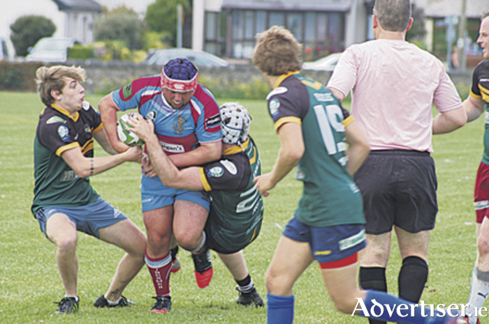 Aaron Byrne  breaks though a double-tackle before sealing victory for the Tribesmen.