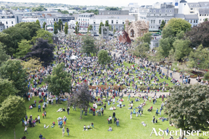 Thousands descended on Eyre Square at the weekend to see The People Build, where some 150 people transformed 1.6 tonnes of cardboard into a monument which rose up over Eyre Square as part of Galway International Arts Festival. Inspired by the Aula Maxima in NUI Galway, the building was part of a spectacular architectural event devised by French artist Olivier Grossetete. Then on Sunday the public joined forces in a massive celebratory demolition as the cardboard building came tumbling down. The event was sponsored by Walsh Waste who recycled the cardboard after the event. Galway International Arts Festival continues until Sunday July 30. For more see giaf.ie  Photo Andrew Downes Xposure