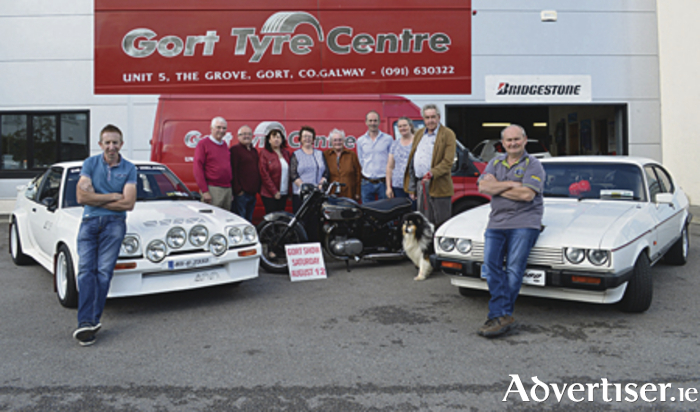 At the Gort Show official launch were: Sean Casey on a 1985 Opel Mantra; Padraic Giblin, treasurer;  Adrian Feeney, owner of 1953 motor bike; Anne McInerney, manager Gort Credit Union;Mary Moloney, chairperson Gort Show; Kitty McGrath, Gort Show committee; Keith Kilcarr, Gort Tyre Centre; Fidelma Larkin, PRO Gort Show; Pat O'Donnell, Gort Show dogsection with his prize winning rough collie, Rufus; and Noel Fahy with his 1984 Ford Capri.