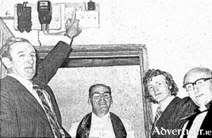 The Minister for the Gaeltacht, Denis Gallagher, performing the official switching on of a new electricity scheme on Inishbiggle in 1977. Watching on are Very Rev Mark Diamond PP, Ballycroy, Enda Kenny TD, and Dean Herbert Friess, Rector, Achill.