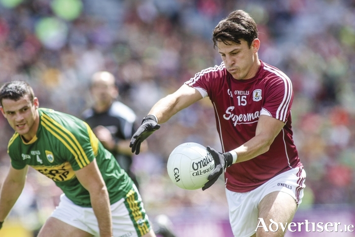 Galway's Sean Armstrong takes a point watched by Shane Enright of Kerry  in the GAA Football ALL Ireland Senior Championship quarter-final in Croke Park on Sunday. 					Photo:- Mike Shaughnessy