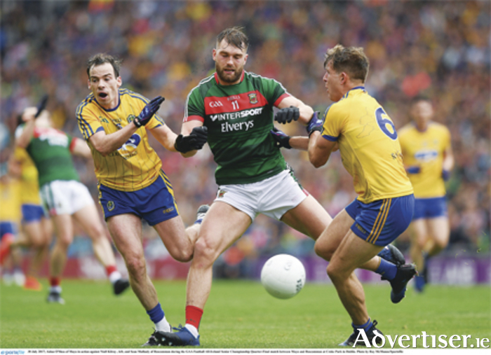 Niall Kilroy and Sean Mullooly get to grips with Mayo's Aidan O'Shea last weekend at Croke Park. Photo: Ray McManus/Sportsfile