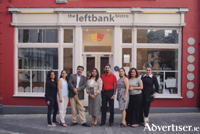 Indian tour operators with Kavya Chawla, Tourism Ireland (fourth left), outside The Left Bank Bistro in Athlone. Photo: Corin Bishop
