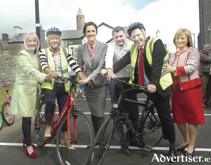 "Minister for Rural and Community Development Michael Ring TD and Ballina Municipal District's Cathaoirlach Cllr Annie May Reape took to their bikes to promote North Mayo Tourism after the Minister officially opened the €650,000 Phase 2 ""Monastries of the Moy"" Greenway. Delighted to give them their extra support ""push"" on their way were Ballina Municipal District MD Marie Crowley, Senator Michelle Mulherin, Cllr Jarlath Munnelly and Carmel Murphy from Mayo County Council. Photo: Henry Wills."