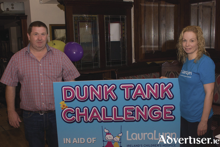 Shane and Geraldine O'Neill who will host Ballinrobe's 'Dunk Tank' challenge in Art O'Neill's bar on Friday next. Photo: Gerard O'Malley.