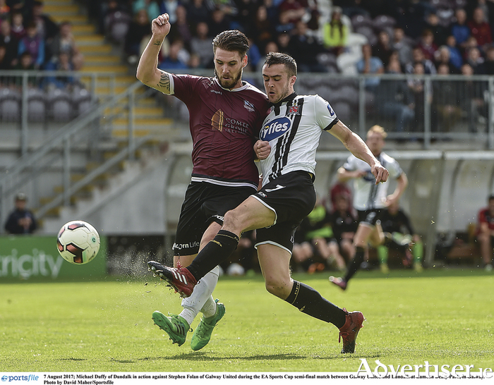 Stephen Folan of Galway United in action against Michael Duffy of Dundalk during the EA Sports Cup semi-final match between Galway United and Dundalk at Eamonn Deacy Park on Monday.