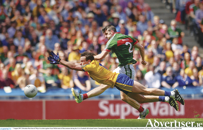 Sean McDermott of Roscommon up against Mayo's Brendan Harrison. Photo: Ramsey Cardy/Sportsfile