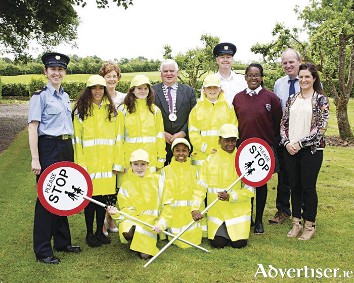 Back row: Ann Marie McKeon, road safety officer with Longford County Council; Cllr PJ Reilly, chairperson of Longford County Council; Garda Superintendent James Delaney; Colm Smith, Road Safety Officer with Westmeath County Council. Front: Garda Breda Smyth, Joyce Baltazar, Rebecca Goddard, Vaari Hourigan, Alisha Collins (sub), and Catherine Hannon, teacher.