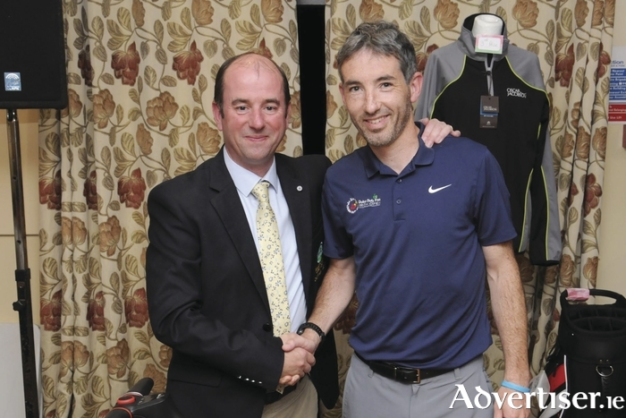 Shane Freeman winner of the Captain's Prize at Ballyhaunis Golf club being congratulated by Martin McDermott (captain). Photo: Glynns Photography.