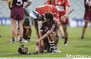 Aoife Donohue is consoled by Ashling Thompson during the All-Ireland Senior Camogie Championship semi-final between Cork and Galway at the Gaelic Grounds in Limerick. Photo by Diarmuid Greene/Sportsfile.