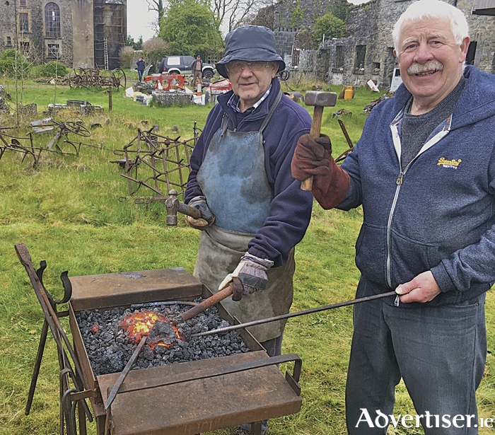 Michael Tiarnan and Mike Joyce of Cumann na bhFear blacksmithing at a recent heritage event in Castle Ellen, Athenry.