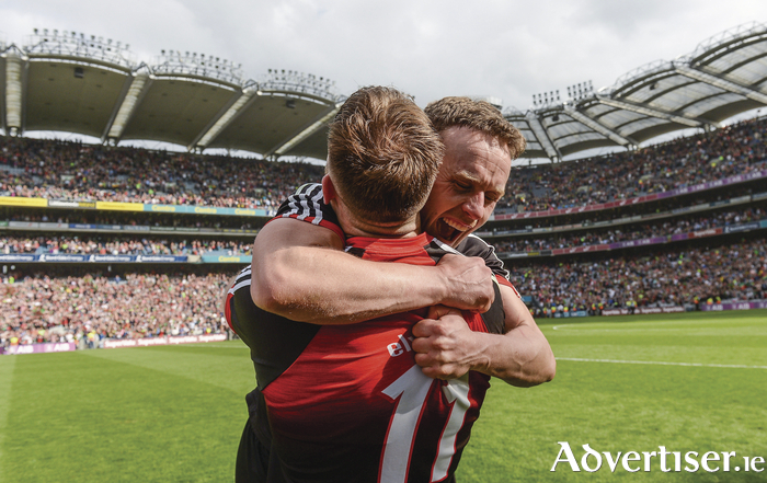 One more step: Andy Moran and Aidan O'Shea celebrate at full time. Photo: Sportsfile