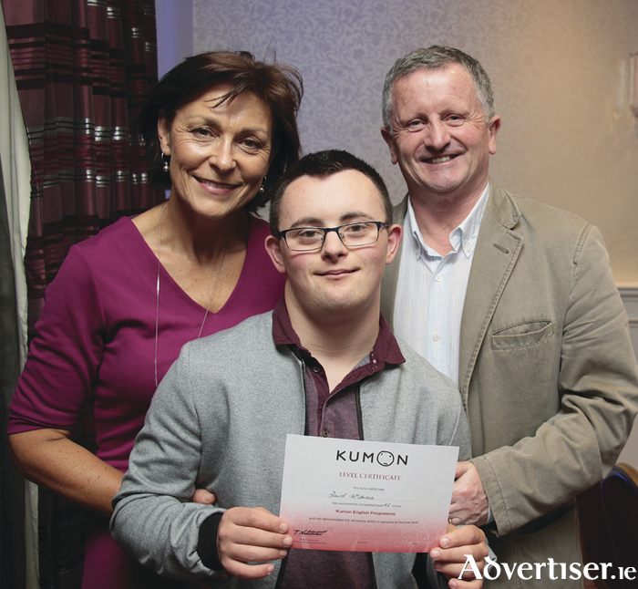 Davis McAnena with his proud parents Monica and Frank at the Kumon graduation ceremony at the Menlo Park Hotel on Thursday. Photo: Mike Shaughnessy.
