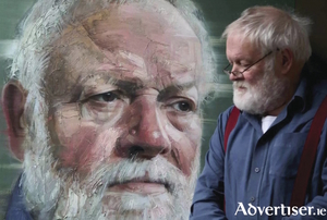 Poet Michael Longley views his portrait painted by Colin Davidson.