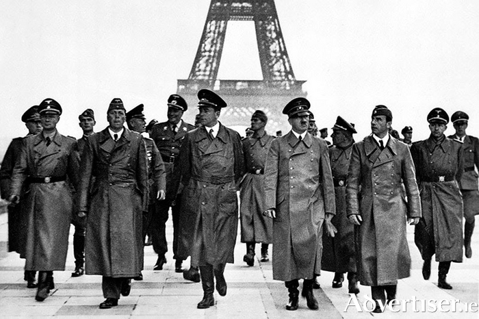 Hitler arrives in Paris in 1940.