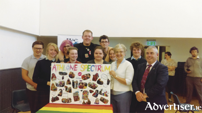 Minister Zappone and Kevin 'Boxer' Moran with members fo the Athlone Spectrum LGBTI youth group.