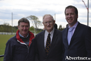 Padraic Carney with Kieran Peyton (Swinford GAA club )and Michael Murtagh (Swinford GAA) chairman, at the re-dedication of Swinford GAA pitch after Garda Robert McCallion in 2012. Photo: Michael Maye