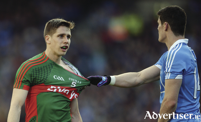 Stretching it out: Lee Keegan eyes up Diarmuid Connolly in last years final replay. Photo: Sportsfile