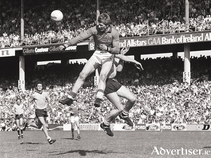 Up and away: Eugene Lavin rises high to clear the ball against Dublin in 1985. Photo: Sportsfile
