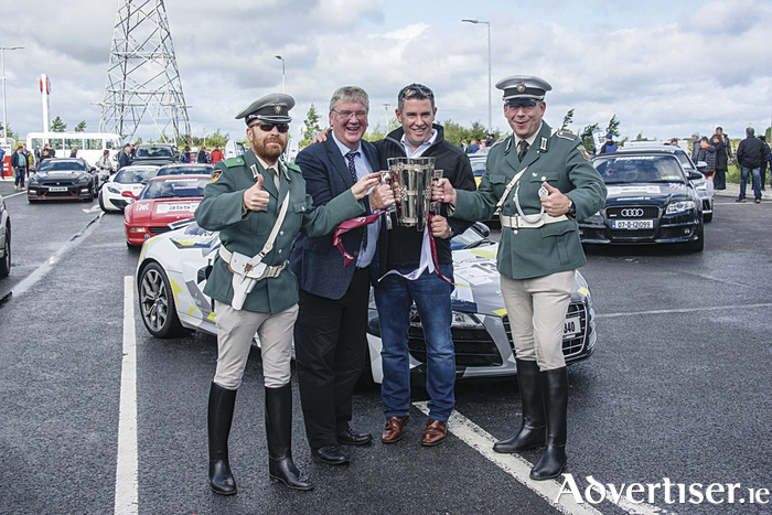 Pat McDonagh of Supermac's with Enda Conboy of Cannonball Ireland with the Liam McCarthy Cup being closely guarded by the German Police at the Cannonball Run in The Galway Plaza on Saturday.