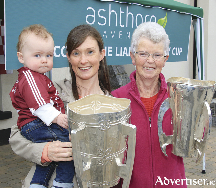 Aoife and Dara Craddock along with Anne Donnelly  with the All Ireland Hurling Championship cups at the release of the latest homes in the Ashthorn Avenue development in Headford on Saturday. Photo:- Mike Shaughnessy
