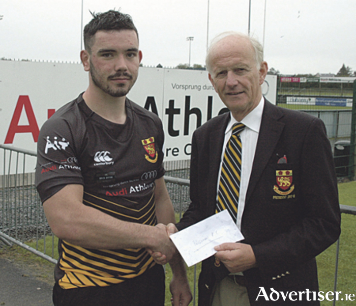 Paul Boyle is presented with the Audi Athlone Man of the Match Award by club president, Tom Meagher