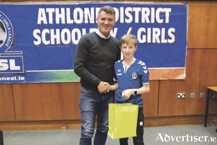 Roy Keane accepts a presentation from ADSL U14 player, Ben Donegan