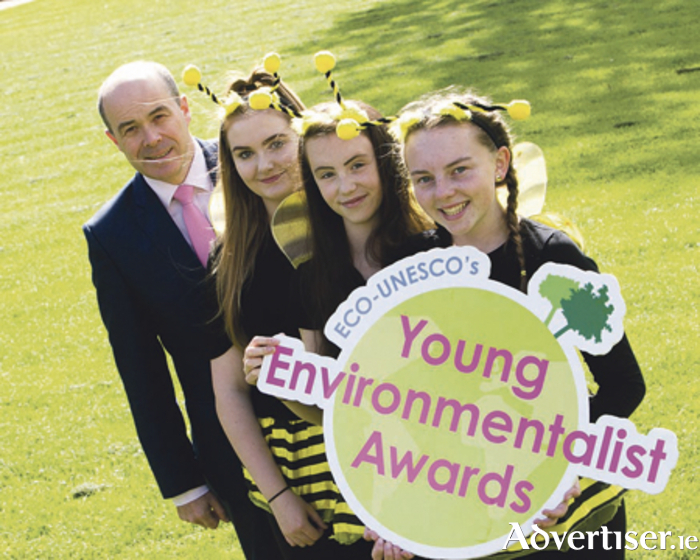 Minister for Communications, Climate Action and Environment, Denis Naughten, with Emma Fowler, Niamh NiMoraine, and Aoife Whelan, winners of the Junior Overall Award and Junior Biodiversity Award last year