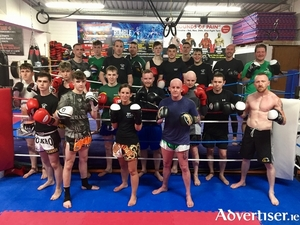 Ready for action: Galway Black Dragon Kickboxing Club fighters prepare for title fights on Sunday: Back, Colm Dunphy, Alex Fitzpatrick, Tom Scarry, Peter Sheppard, Cian McCormack, James Kelly, Gytis Lisinskas, Ryan Ali, Gary Manogue, Joe Mc Cormack. Middle, Sean Ryan, Joey Gallagher, Damien Creavin, Thomas O Connor, Dara Mannion, Ultan Connell. Front, Oisin Concannon, Ben Devlin, Whitney Sheppard, Paul Huish, Gary Elbert.