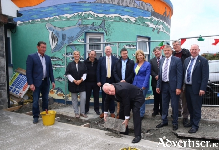 Minister Michael Ring TD. laying the first block on second phase of Achill Experience. Left to right: Hugh Golden (Logden Homes), Sue O'Toole (South West Mayo Development Company), Gerry Hassett (Chairman of Achill Tourism and North West FLAG), Terence Dever (CEO CFAA and Achill Experience), Shane Heffernan (Lally Engineers), Senator Rose Conway Walsh, Pat Kilbane (Chairman of CFAA), Cllr Michael Holmes  (Chairman of West Mayo Municipal District), Sean Quinn (Logden Homes) and Tom Gilligan (Director of Services Mayo County Council).