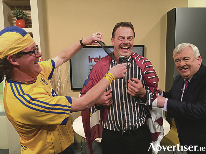 Ireland's most famous barber Paddy Joe Burke of Roscommon prepares to shave Galway hurling legend Gerry McInerney's moustache while he is held in place by Ireland AM's Aidan Cooney. Gerry will be shaving his moustache next Monday for the first time since he was 18 in aid of the Tony Keady Family fund.