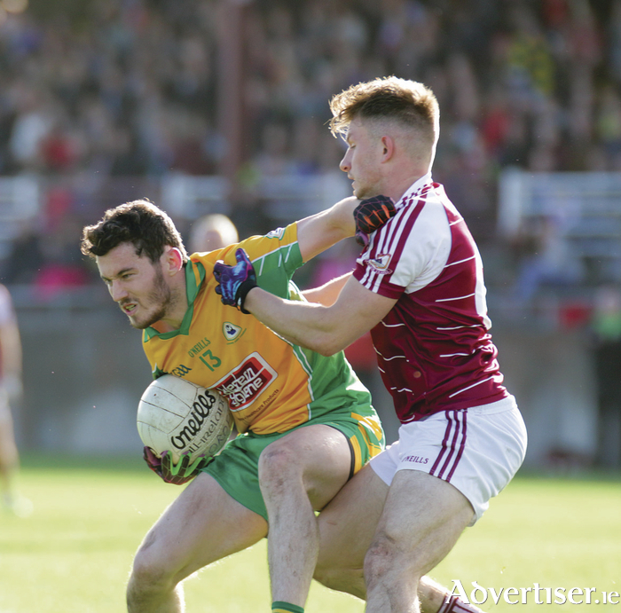 Ian Burke of Corofin comes under pressure from Eoghan Kerin of Annaghdown in the Galway GAA Senior Football championship semi-finals at Tuam Stadium.  Photo:- Mike Shaughnessy