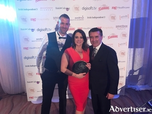 Joe Joyce and Triona Joyce (marketing manager of The Wyatt Hotel) who were the winners of Ireland's Best Hotel Website at the 2017 Gold Medal Awards with TV3 presenter Martin King.