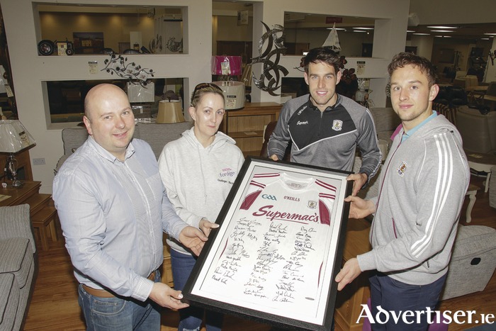 Declan Gannon of G Furniture presents Cathy Killeen, Menlo, with a signed Galway Hurlers jersey. Also in the photo are Galway hurlers  Gearoid McInerney and Niall Burke. Cathy won the prize in G Furniture's recent Facebook competition.  Photo:- Mike Shaughnessy