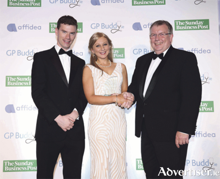 Dr Laura Noonan accepting the award for Establishing GP of the Year, presented by Joe Newell, CEO of GPBuddy.ie, and David Sharpe, managing director at Ionic. Photo: Robbie Reynolds