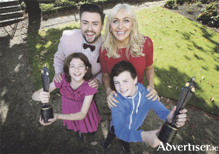 Miriam O'Callaghan and Celebrity Operation Transformation contestant James Patrice alongside former winners Aoibheann Mangan (11) from Hollymount, Mayo, and Padraic Goodwin (12) from Cloghans Hill, Tuam, Galway. Photo: Mark Stedman